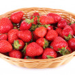 Ripe sweet strawberries in wicker basket, isolated on white — Stock Photo #48448881