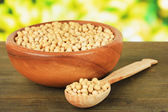 Soy beans on table on bright background — Stock Photo