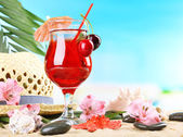 Refreshing cherry cocktail on sand beach  — Stock Photo