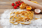 Still life with raw homemade pasta and ingredients for pasta — Stock Photo
