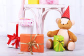 Many birthday gifts in room — Stock Photo