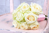 Beautiful wedding bouquet with roses on grey wall background — Stock Photo