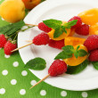 Fresh fruit kebabs for healthy snack on plate close up — Stock Photo #48453509