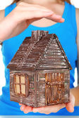 Small wooden house in hands, close up — Stock Photo