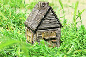 Small wooden house on grass, outdoors — Stock Photo