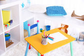 Modern playroom for children with bright table — Стоковое фото