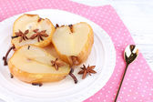 Baked pears with syrup on plate, on color wooden background — Stock Photo