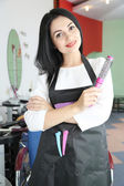 Beautiful woman hairdresser in beauty salon — Stock Photo