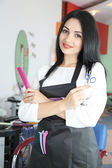Beautiful woman hairdresser in beauty salon — Zdjęcie stockowe