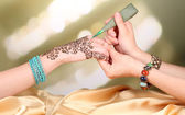 Process of applying Mehndi on female hand, close up — Stock Photo
