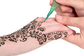 Process of applying Mehndi on female hand, isolated on white — Stock Photo