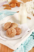 Milk and cookies on tray on table — Stock Photo