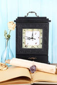 Still life with old retro clock on blue wooden background — Stock Photo