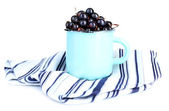 Black currant berries in mug isolated on white — Stock Photo