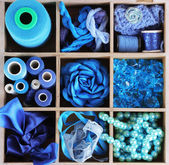 Blue thread and material for handicrafts in box — Stock Photo