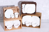Beautiful shelves and boxes with tableware — Stock Photo
