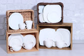 Beautiful shelves and boxes with tableware — Stockfoto