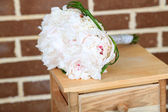 Beautiful wedding bouquet on   wooden stand — Stock Photo