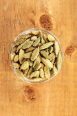 Green cardamom in glass bowl — Stok fotoğraf