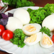 Boiled eggs on plate — Stock Photo #48600141