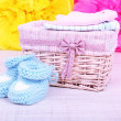 Baby clothes in basket on floor in room — Stock Photo #48601665