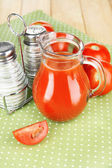 Tomato juice in glass jug — Stock Photo