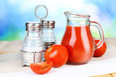 Tomato juice in glass jug — Stockfoto
