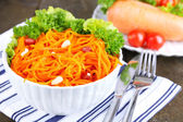 Carrot salad on plate on napkin — Stok fotoğraf