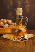 Walnut oil and nuts — Stock Photo