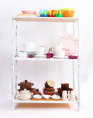 Different tableware on shelf — Stock Photo