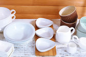 Different tableware on shelf, on wooden background — Stock Photo
