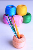 Colorful clews and crochet hooks — Stock Photo
