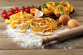 Raw pasta and ingredients for pasta — Stock Photo