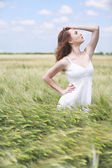 Beautiful young woman in field — Stock Photo