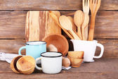 Composition of wooden cutlery, pan, bowl and cutting board — Stock Photo