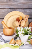 Composition of wooden cutlery, mortar, bowl and cutting board — Stock Photo