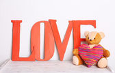 Decorative letters forming word LOVE with teddy bear — Stock Photo