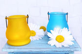 Bright icon-lamps with flowers on wooden stand — Stock Photo