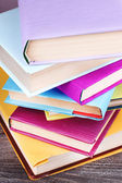 Stack of colorful hardback and paperback books — Stock Photo