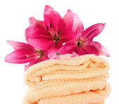 Color towels and lily flowers — Stock Photo