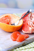 Ripe grapefruits on cutting board — Stock Photo
