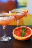 Grapefruit cocktail in glasses — Stock Photo