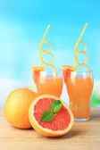 Grapefruit cocktail with cocktail straw — Stock Photo