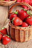 Strawberries in wicker basket — Stock Photo