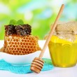 Sweet honeycombs in bowl and bank with honey on wooden table — Stock Photo #48712893