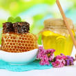Sweet honeycombs in bowl and bank with honey on wooden table — Stock Photo #48712969