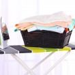 Basket with laundry and ironing board — Stock Photo #48716091