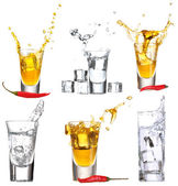 Collage of glasses vodka with splashes — Stock Photo