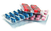 Capsules and pills packed in blisters — Stock Photo