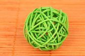 Wicker bamboo ball on bamboo mat — Stock Photo